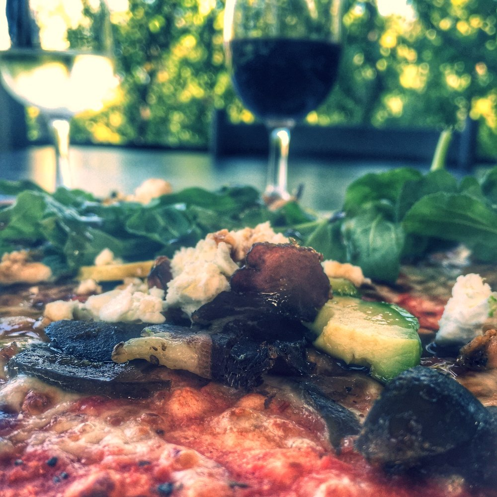 Brenaissance Wine & Stud Estate offers a dramatic wine and pizza pairing. This pairing is of the rich Biltong and Fig Pizza with the Merlot.