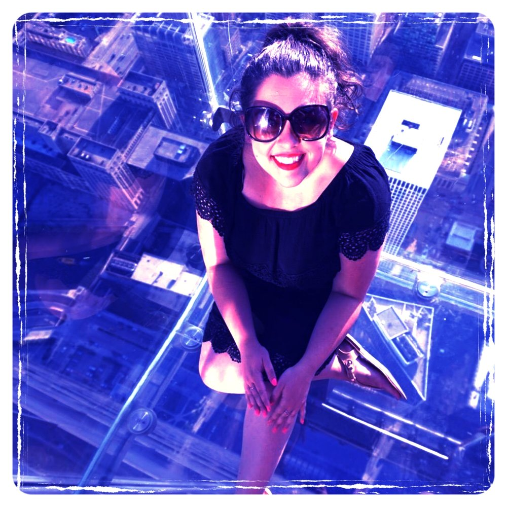 Alex gets a birds eye view of the Windy City from the glass Skydeck at Chicago's famous Willis Tower, which hovers 1,353 feet above the city sidewalks.