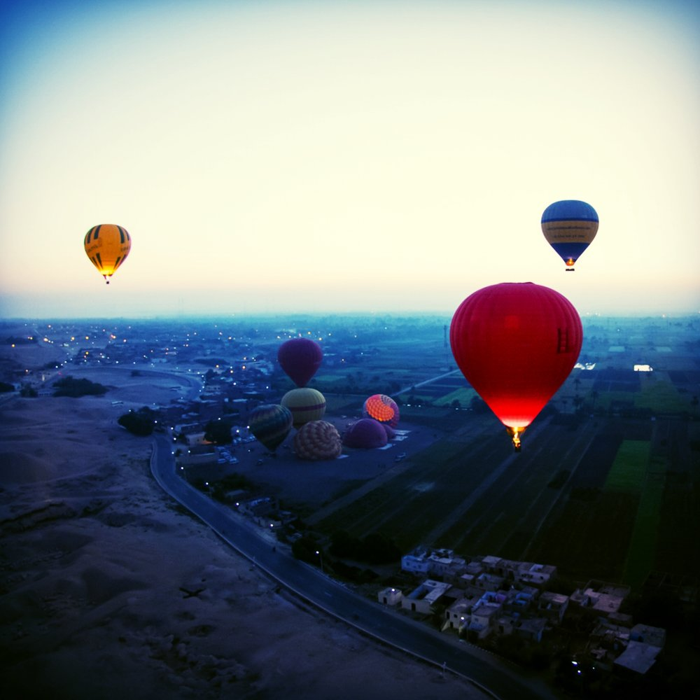 Sunrise hot air balloon ride over Luxor, Egypt.