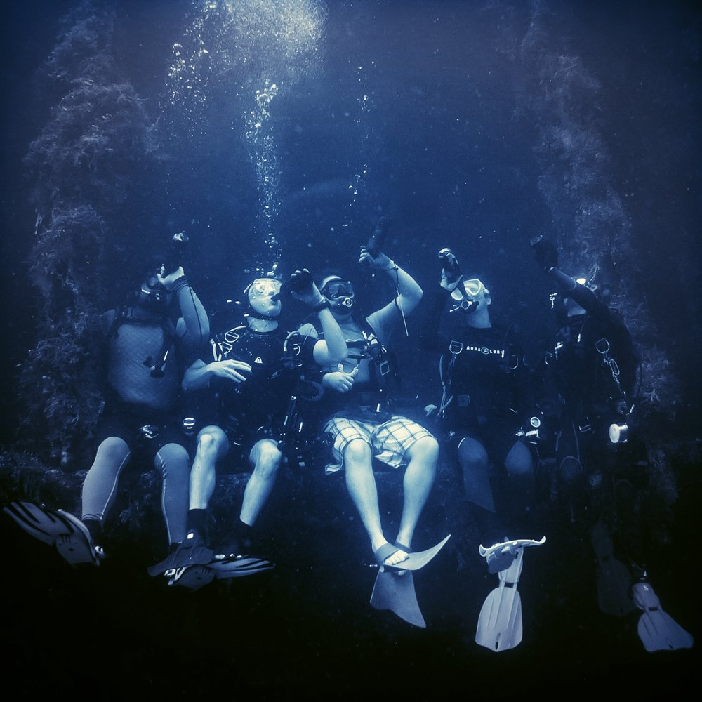 My diver friends outside the Bottle Room on the Rio de Janeiro Maru in Truk Lagoon, Micronesia.
