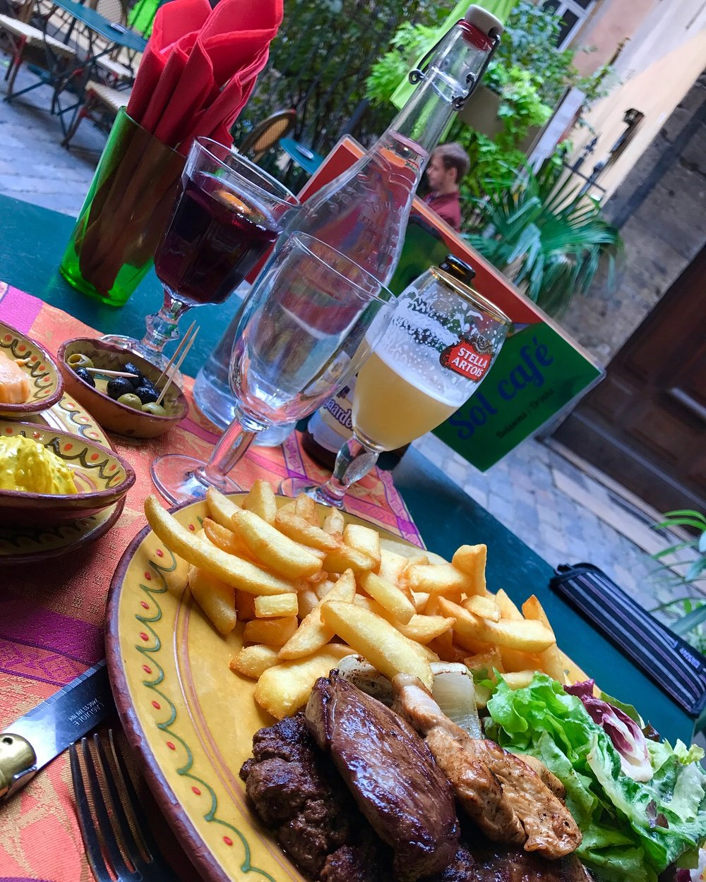 Eating and people watching are two of my favorite pastimes. (Steak and frites in Vieux Lyon)