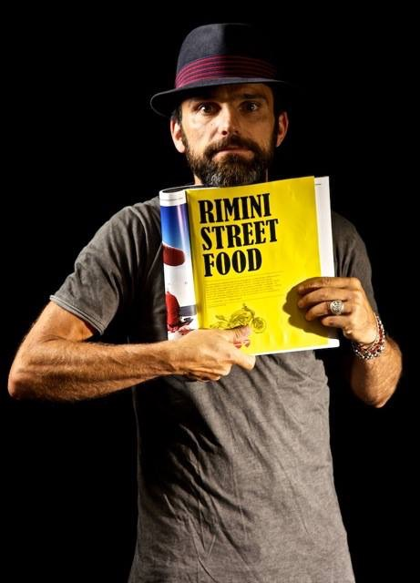 Posing with an article about the first project dedicated to street food involving one and two Michelin star chefs.