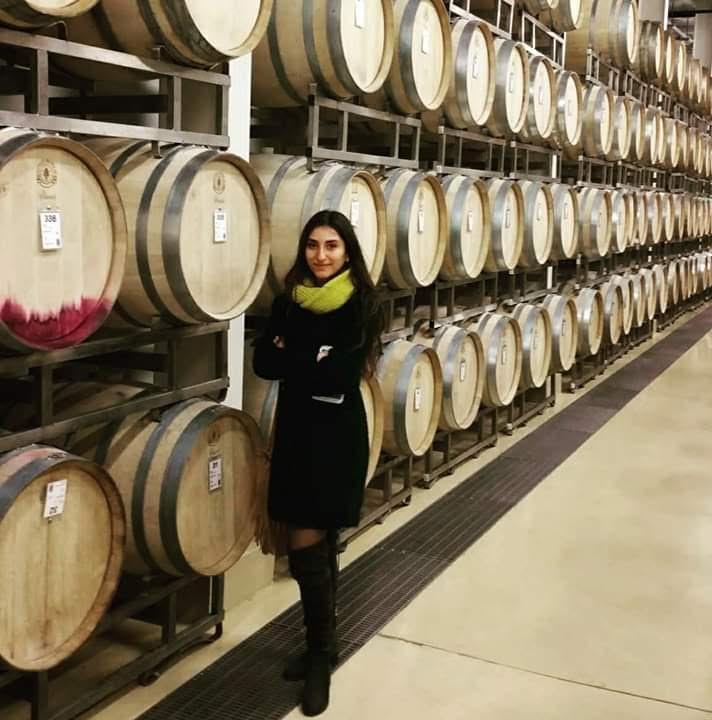 In the Karas Wines barrel room.