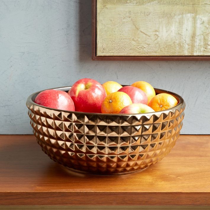 West Elm's metallic bowl filled with apples.