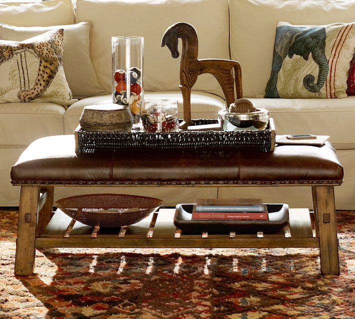Coffee table bench from Pottery Barn is tablescaped with collections on a tray. Photo: Pottery Barn.