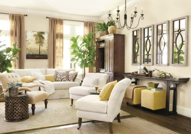 From Ballard Designs: Drapes hung just below molding give this beautiful room a balanced look.