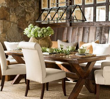 Splurge on dining room table but save on chairs that can be reupholstered when you are ready for a change.     Photo: Pottery Barn.
