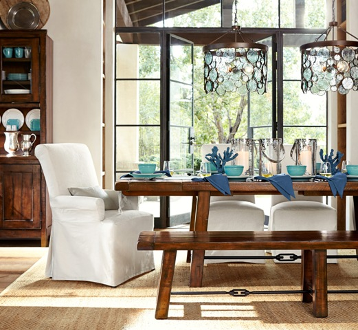 Pottery Barn's pretty spring table with turquoise dishes and glass based coral stands.