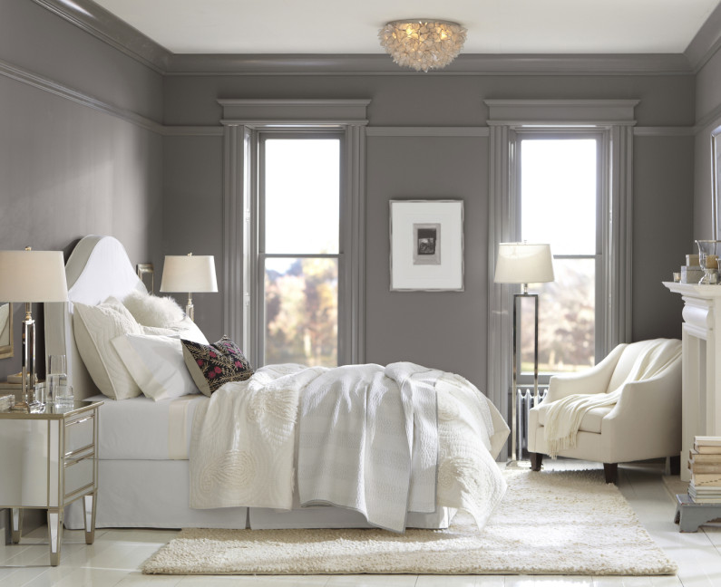 Headboard doubles as a comfortable backrest, creating a cozy spot for reading and relaxing. Available in slipcover options, so it can be changed. Paint color: Sensuous Gray by Sherwin Williams; Light fixture at left: Capiz shells. Photo: Pottery Barn.