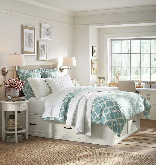 Stratton Bed with drawers for storage, Swing arm-sconces and a porcelain blue duvet. Photo: Pottery Barn.