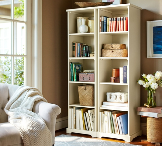 The Samantha narrow bookcase by Pottery Barn is styled with lots of texture and books for a display that will fit into any space. Photo: Pottery Barn.