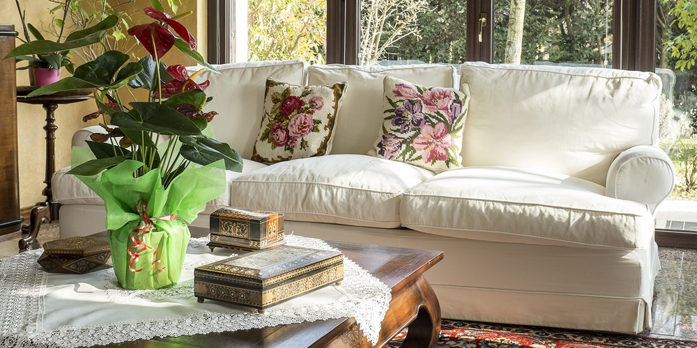 spectacular-spaces-home-interiors_0009_79168727-white-sofa-floral-pillows-in-sunroom.jpg