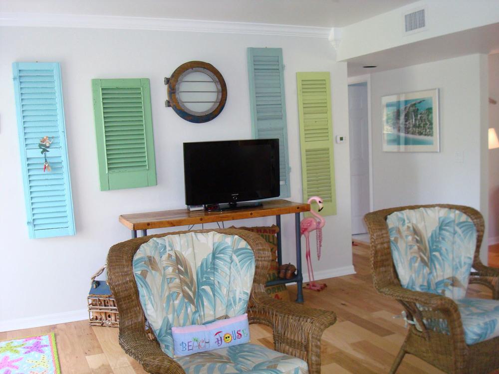 island-beach-house-renovation-blue-green-shutters-on-walls-07.jpg