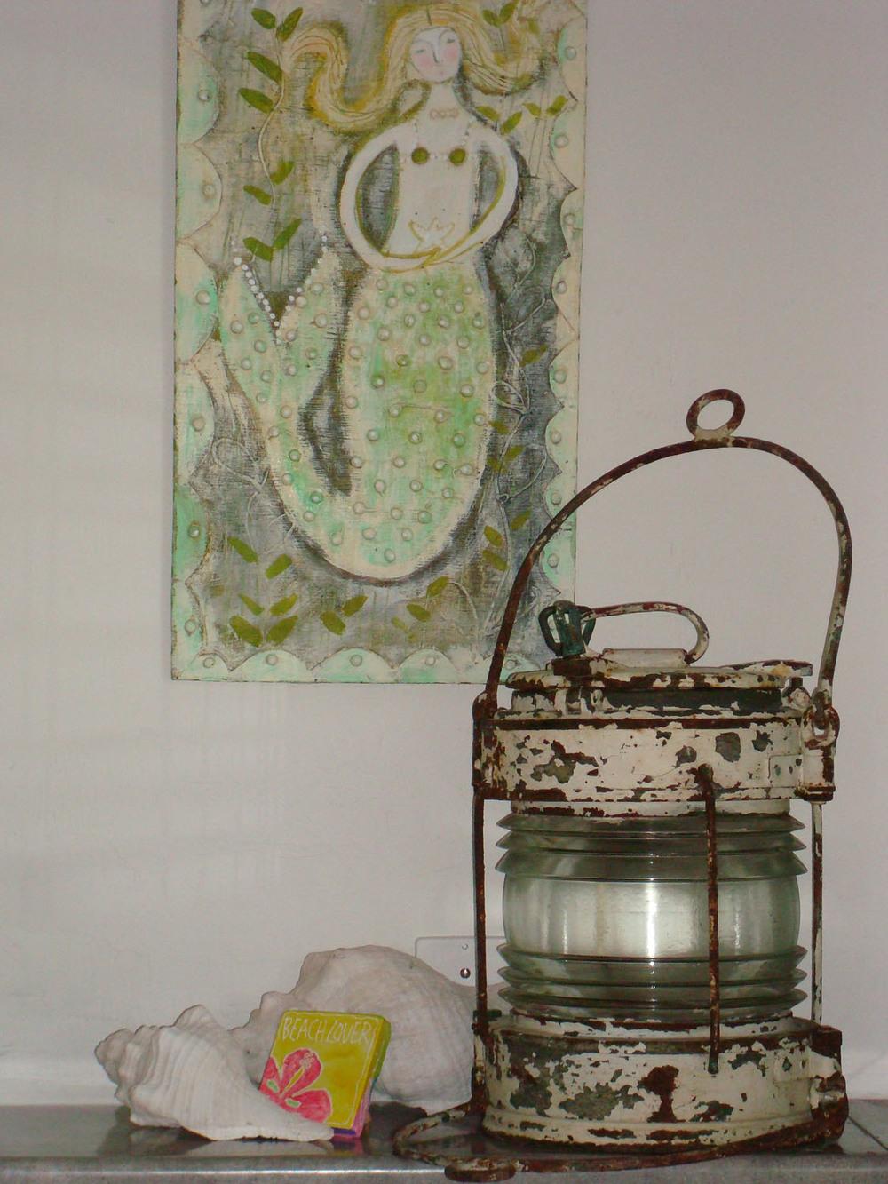 island-beach-house-renovation-decor-accents-old-lamp-mermaid-wall-art03.jpg