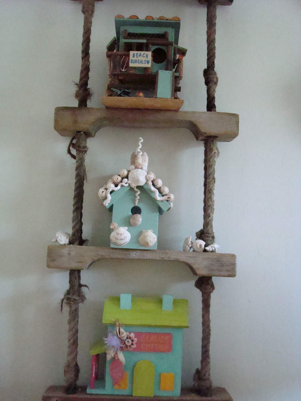 island-beach-house-renovation-whimsical-wall-decor-on-rope-and-wood-ladder-24.jpg