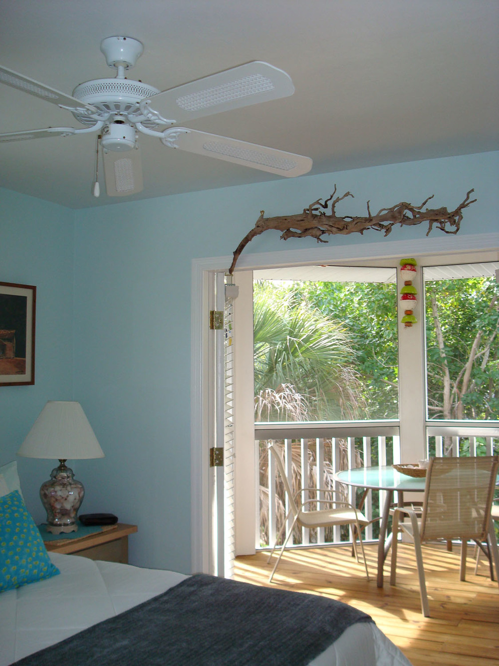 island-beach-house-renovation-bedroom-deck-with-table-doorway-13.jpg
