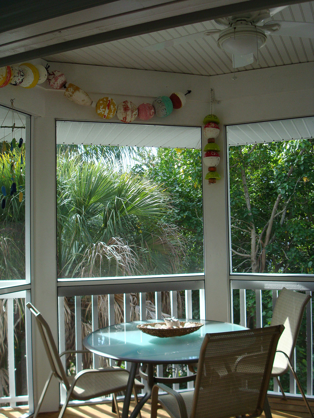 island-beach-house-screened-porch-renovation-eating-area-29.jpg