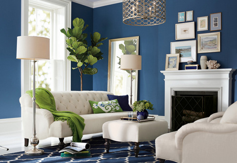 "Declutter and remove personal items and add fresh flowers for a look that says ""welcome to your new home."" This Clara space-saving apartment sofa and ottoman are by Pottery Barn. Photo: Pottery Barn."