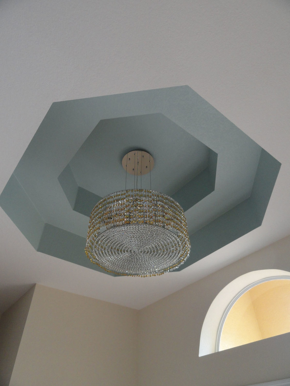 vacation-home-renovation-after-photo-of-entry-tray-ceiling-painted-in-a-benjamin-moore-blue-with-new-chandelier.jpg