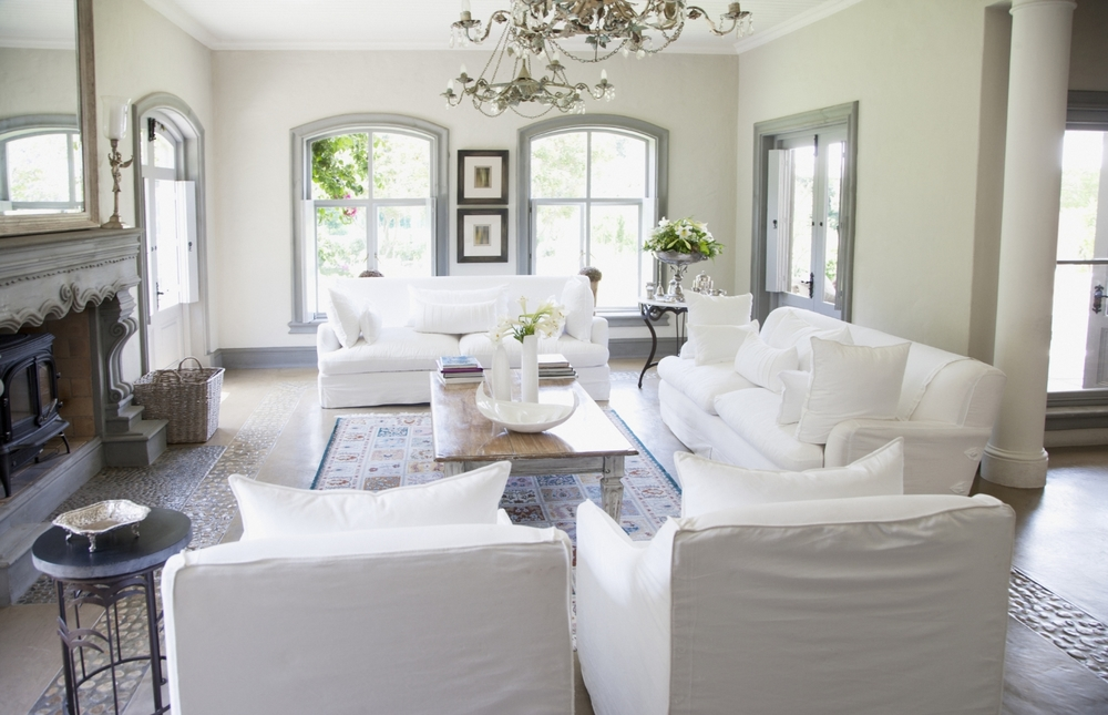 cozy-living-room-with-white-sofas-slip-covered-and-chairs