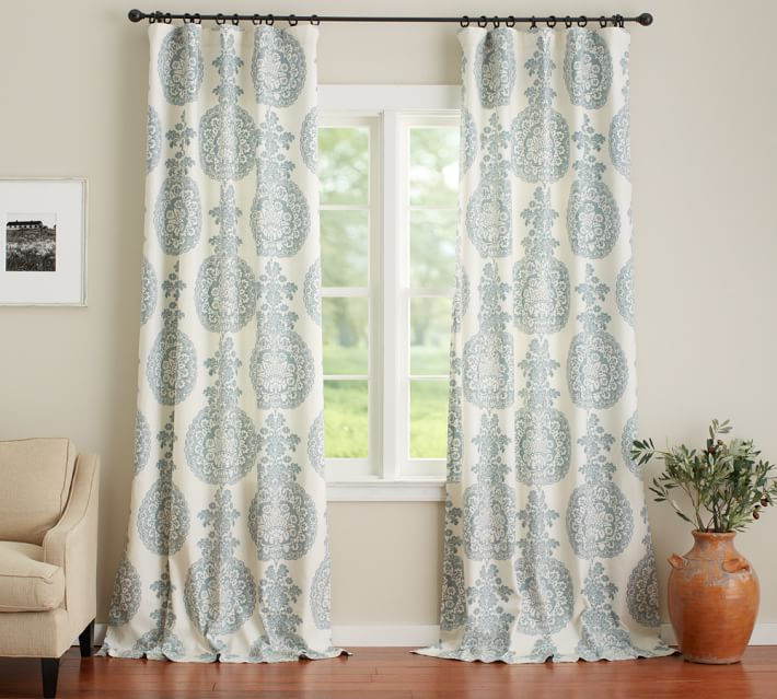 "Pottery Barn's Lucianna Medallion pole pocket drape  is a great ""fix"" to add your own look to windows or sliders. Photo courtesy of Pottery Barn."