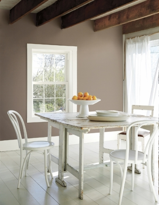 Simple and pretty. Without a lot of fuss, white chairs on white flooring with beautiful walls done in Benjamin Moore's eggshell Welmaraner  (AF-155). Trim is in semi-gloss Simply White (OC-117). A bowl of lemons provides color on the table. Photo: Courtesy of Benjamin Moore.