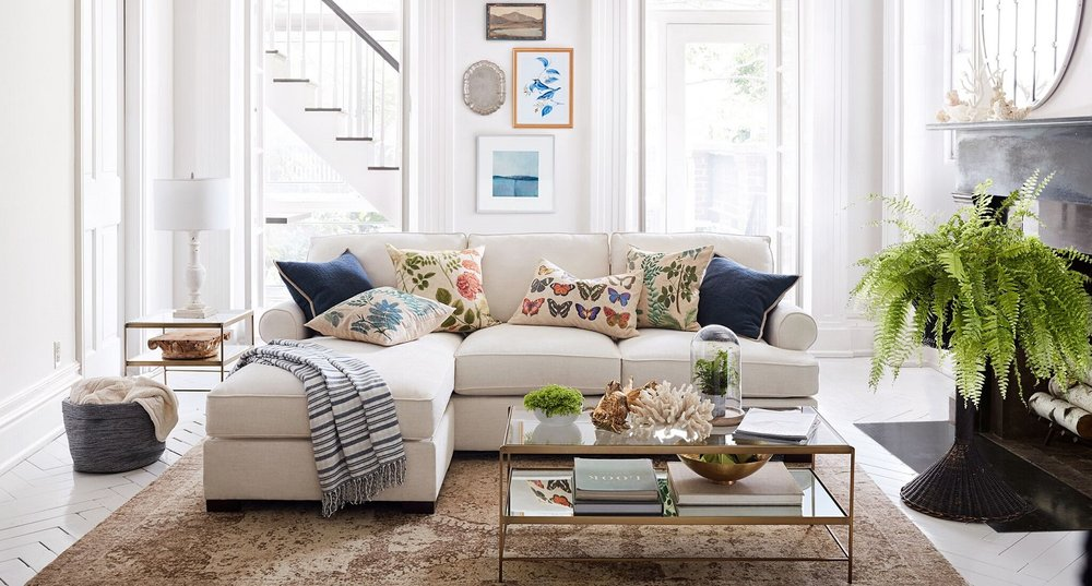 Keep it simple in the New Year. Pillow covers inspired by nature nautical accessories, plants, Leona metallic tables, Jackson chippy base lamps work with this Townsend sofa as a focal point of the room.  Photo courtesy of Pottery Barn.