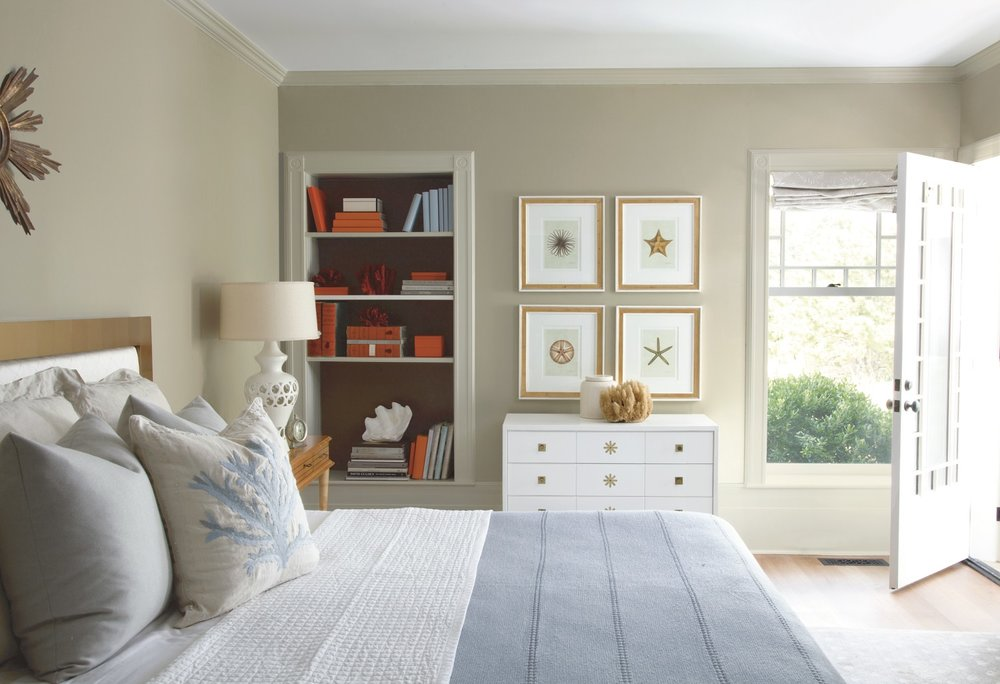Neutrals and beiges are popular in Southwest Florida and can be paired with accent colors in accessories. Wall: Pashima (AF-100). Trim: Winds Breath (OC-24). Bookcase back wall: Silhouette (AF-655).Ceiling: White Heron (OC-57). Photo courtesy of Benjamin Moore.