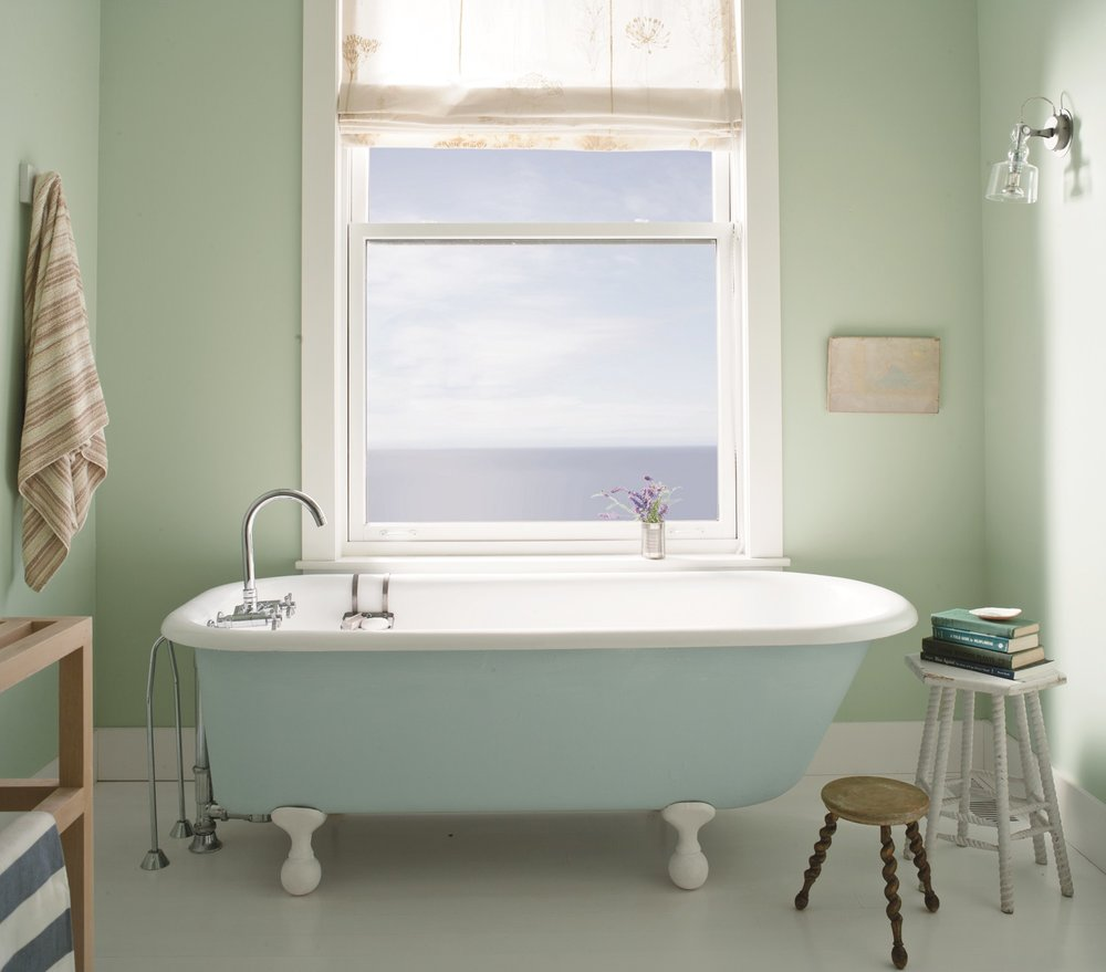 Serene colors in this bath are done with Benjamin Moore's Aura Bath & Spa paint that withstands warm, humid environments. Walls: Palladian Blue (HC-144). Trim: Distant Gray (22124-70). Tub: Breath of Fresh Air (806).   Photo courtesy of Benjamin Moore.
