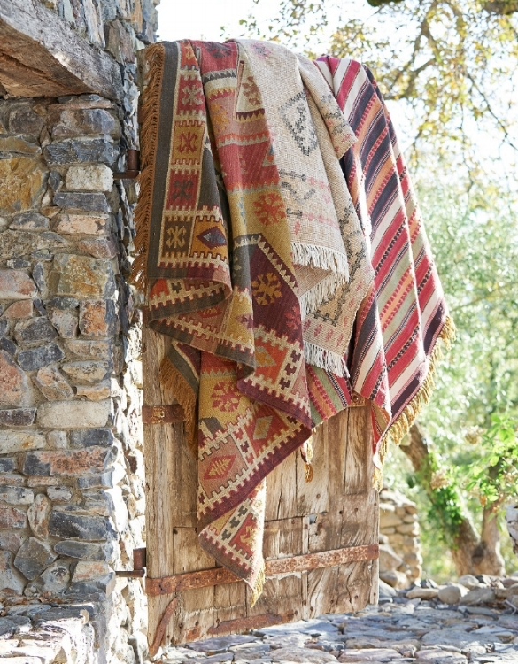 Ancient art and innovative eco-friendly design merge in the Gianna rug from Pottery Barn. Woven on a hand loom, it recreates the soft feel and age-mellowed colors of an antique Turkish kilim using yarns made from recycled soda bottles. Fully reversible for twice the wear, it is yarn dyed for vibrant, lasting color. Use indoors or outdoors. Photo courtesy of Pottery Barn.