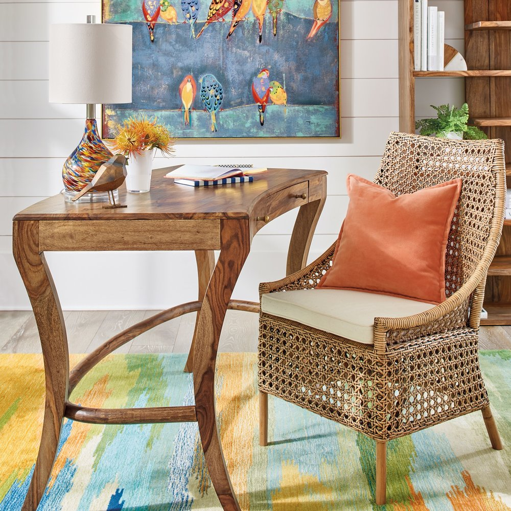 "Wood and rattan warms up a white shiplap wall along with Grandin Road's ""colored birds on a wire"" wall art and colorful ""watercolor"" rug. Photo courtesy of Grandin Road."