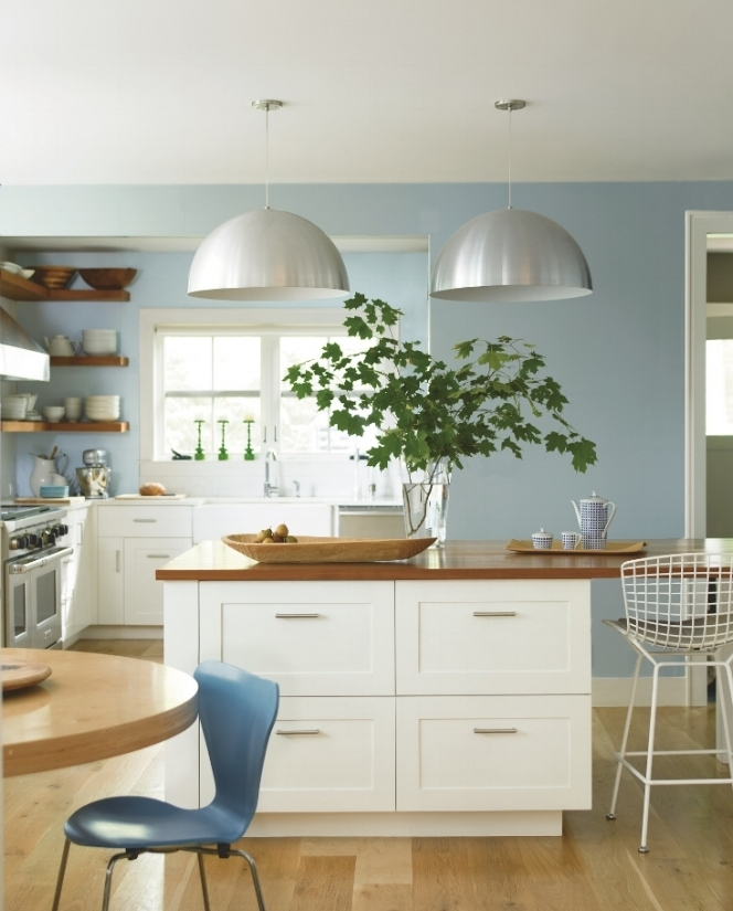 Great light, white cabinets and beautiful blues in this coastal inspired kitchen. Near wall in smoke 2122-40. Far wall in Caribbean Mist 2061-70. Cabinets in Ice Mist OC-67. Photo: Benjamin Moore.