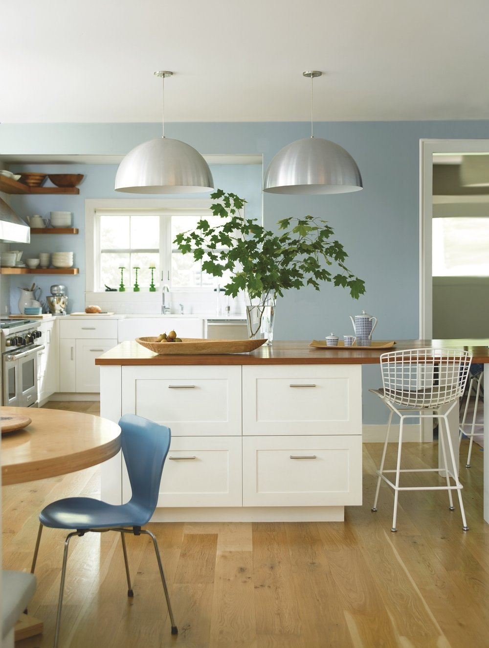 There is a lot to consider in a kitchen renovation: floors, walls, lighting, cabinets. Great light, white cabinets and beautiful blues are the focus in this coastal-inspired kitchen. Near wall in smoke 2122-40. Far wall in Caribbean Mist 2061-70. Cabinets in Ice Mist OC-67. Photo: Benjamin Moore.