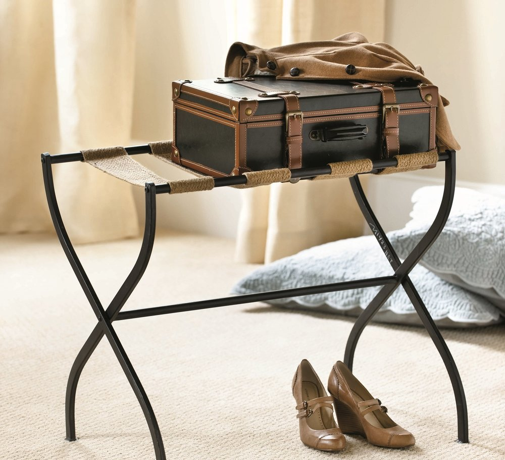 Keep luggage off the guest room floor with a luggage rack. Light and easy to store this Gaspar rack is from Ballard Designs and many homeowners use a couple of these at the foot of their bed for pillows. Photo: Ballard Designs