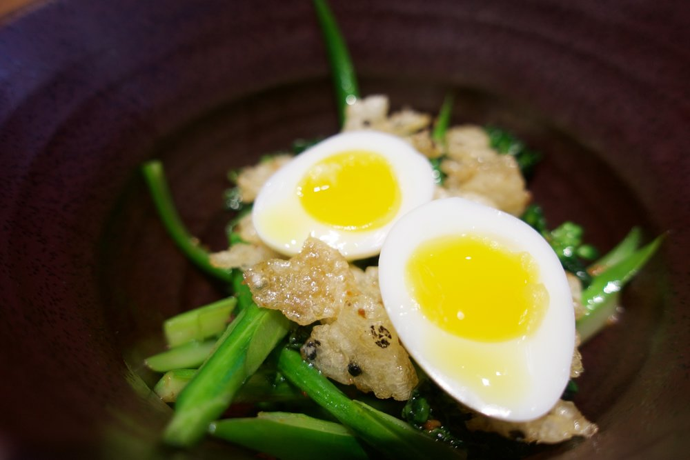 broccolini, fermented bean, rice chips, egg