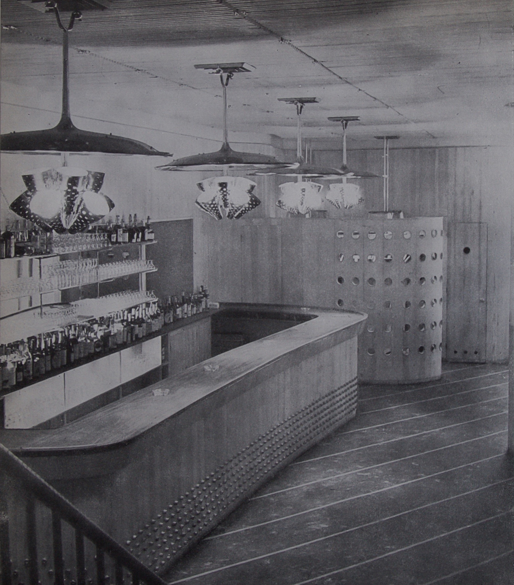 The bar with large custom-made chandeliers by Paavo Tynell, 1947.