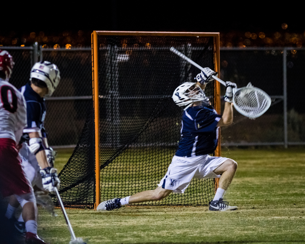 This first night game was very challenging to shoot. Lacrosse is a very fast sport so I had to balance a fast enough shutter speed to freeze the action against a low enough ISO to keep the noise to a tolerable level. You can see motion blur in the goalies stick and helmet.