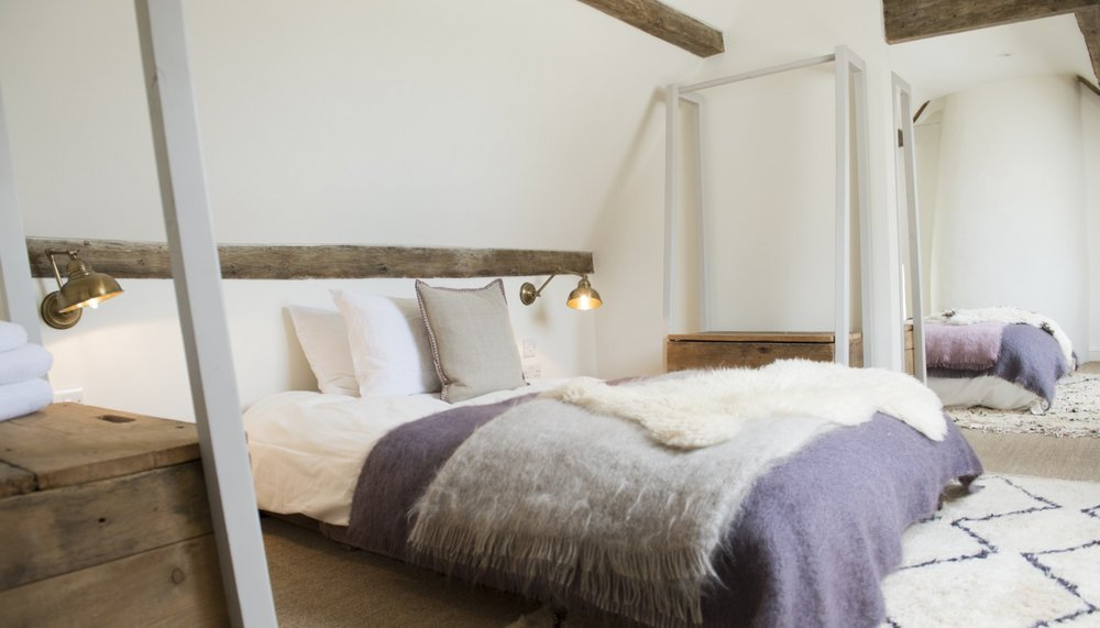 LUXE DORM   Dorms like never before: Skylights, exposed beams and three small double futons, each with a partition in between for privacy. There is a large adjacent bathroom with a standalone bath with a shower head