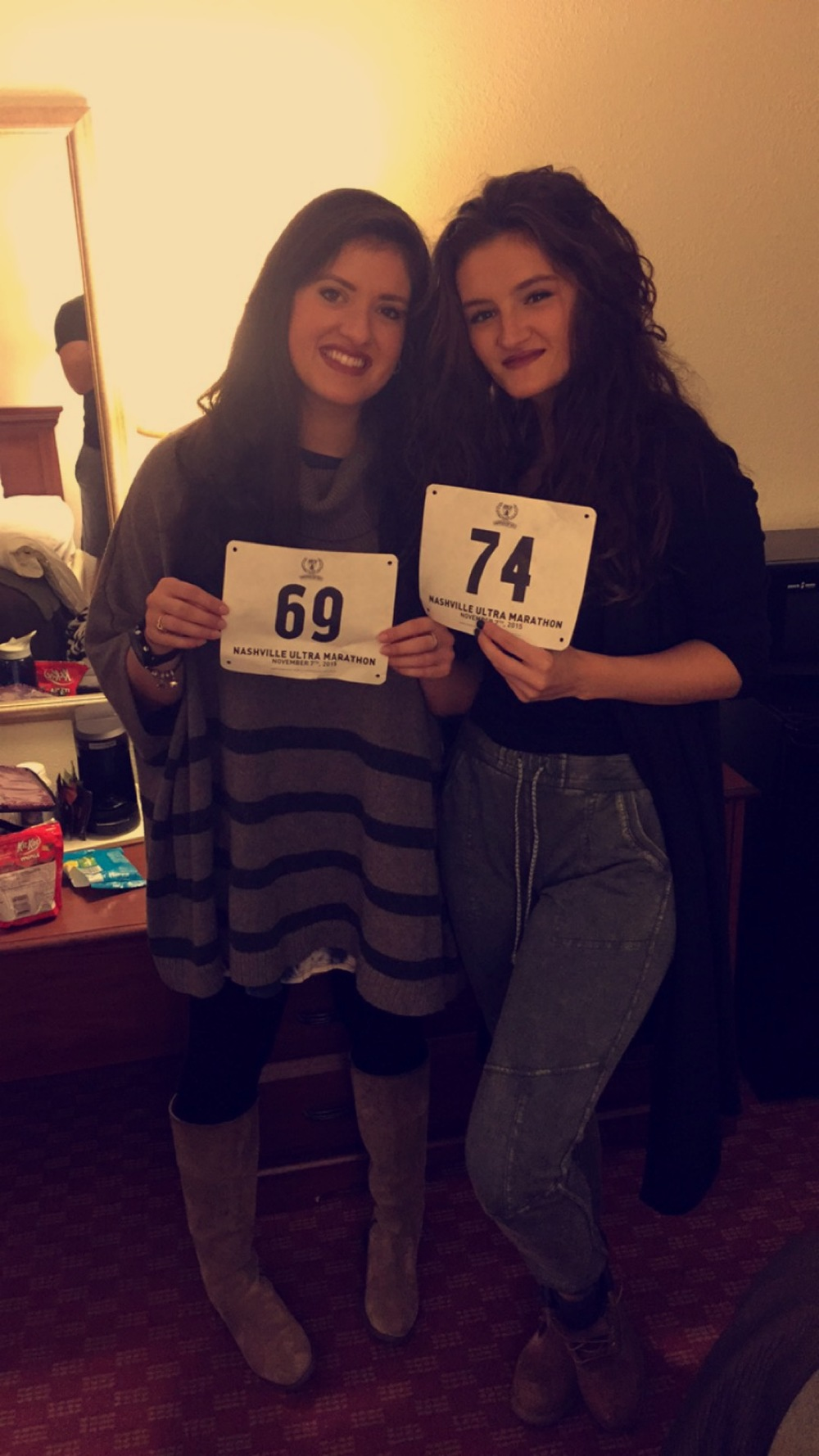 At the hotel with our race bibs