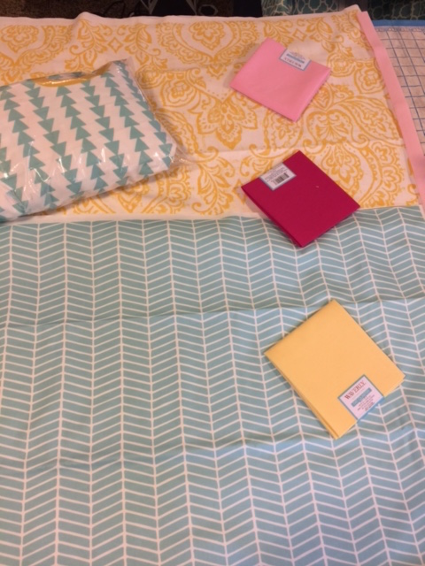 Just a little sneak peak of the nursery color inspirations and some of the fabric we are using!
