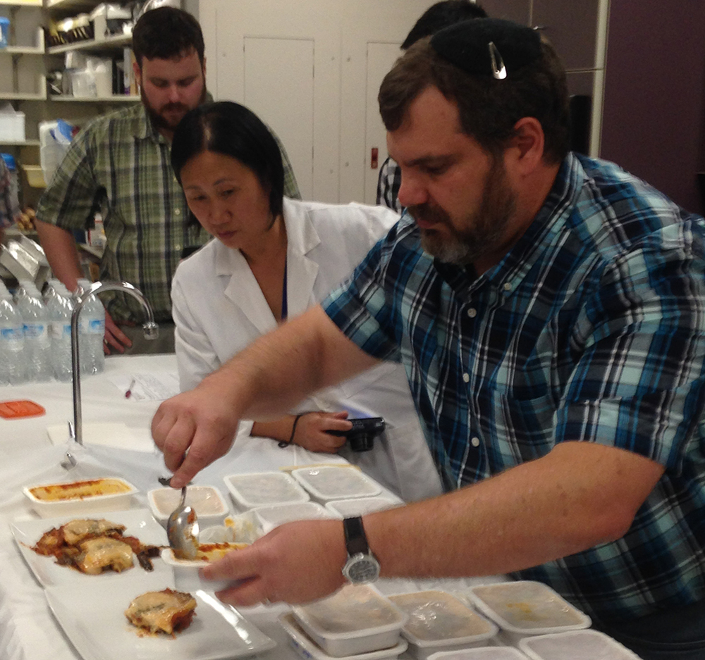 Marcus Brody, Food Scientist at Covance Food Solutions, dishes up the vegetarian moussaka he made and had microwave processed at the 915 Labs MATS Boot Camp.
