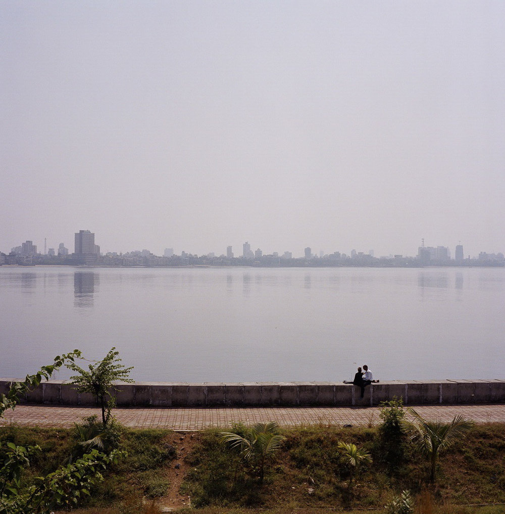 Lovers by the riverbank, India, 2006
