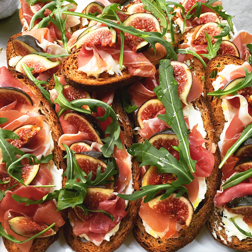Classic Parma ham, fig, rocket and saba crostini