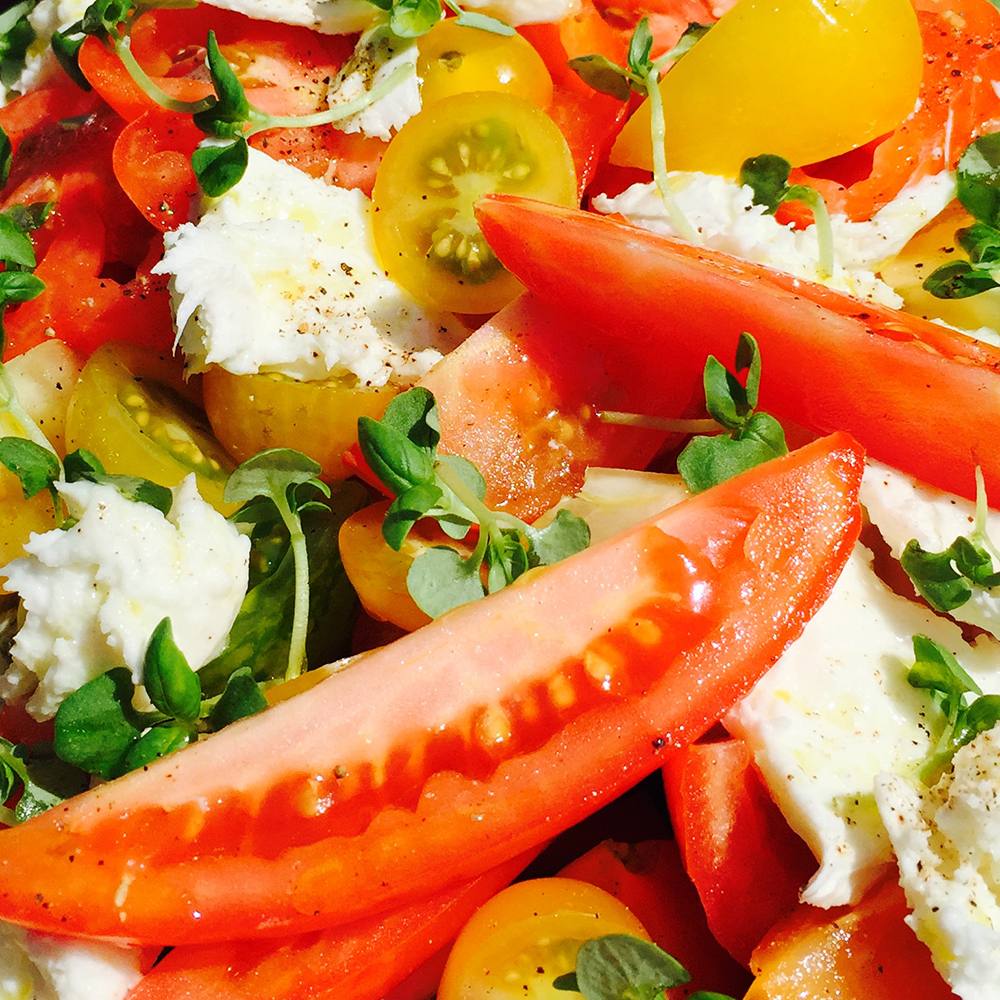 Summer heirloom tomato salad w mozzarella and basil cress