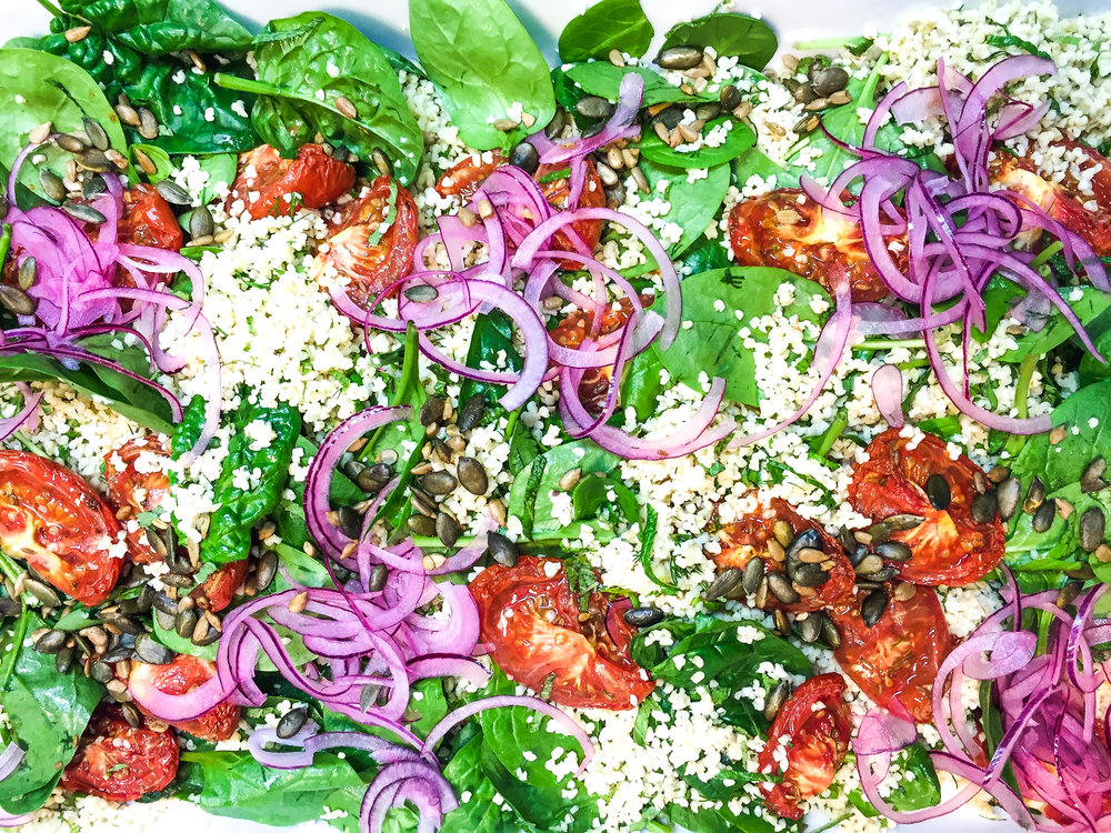 Bulghar w slow roast tomato, pink onions, baby spinach, citrus and seeds