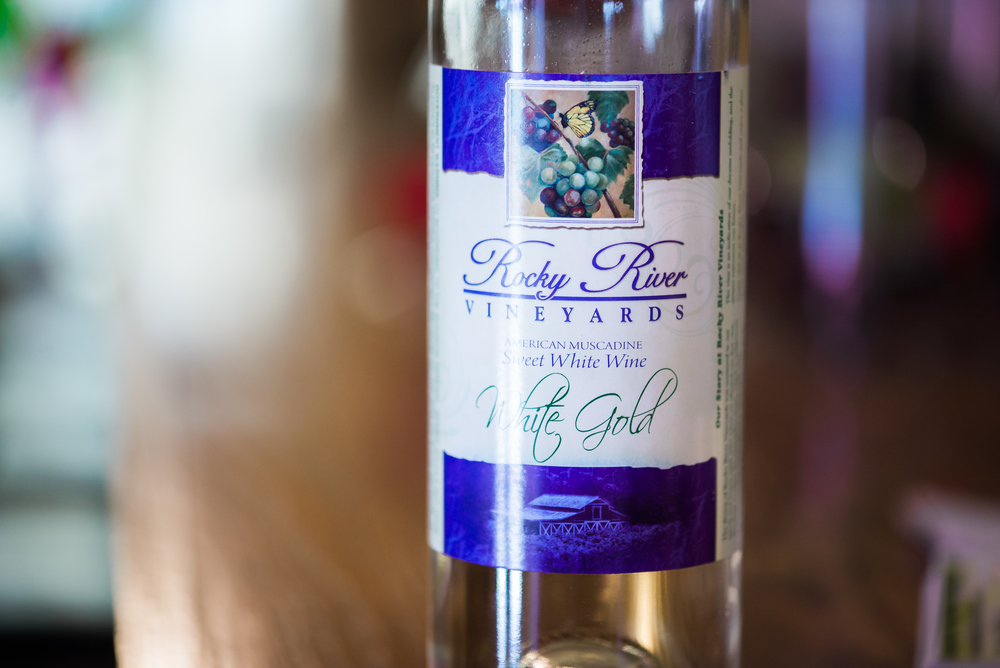 """  Made from the Carlos Muscadine. Sweet and bold with a clean, fresh finish. Simply refreshing. Enjoy White Gold with fresh fruits, cheeses and nuts, also pair with spicy foods."""