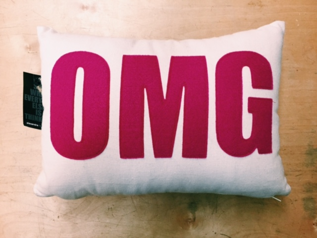 """OMG"" it is a New Year- pillow made from entirely recycled materials in Brooklyn, NY"