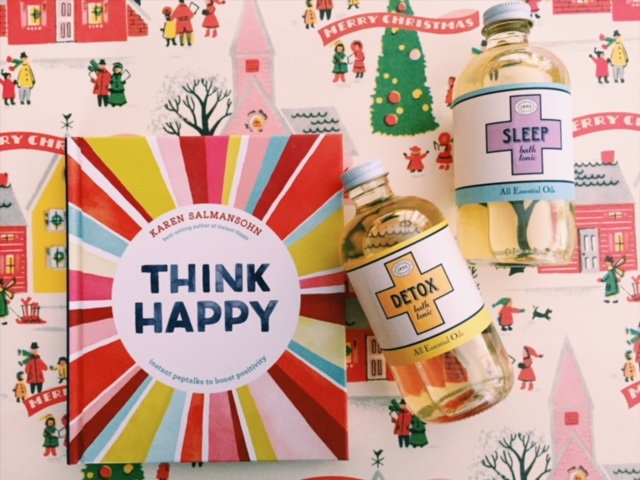 "From left: ""Think Happy"" inspirational book, Detox and Sleep essential bath oils."