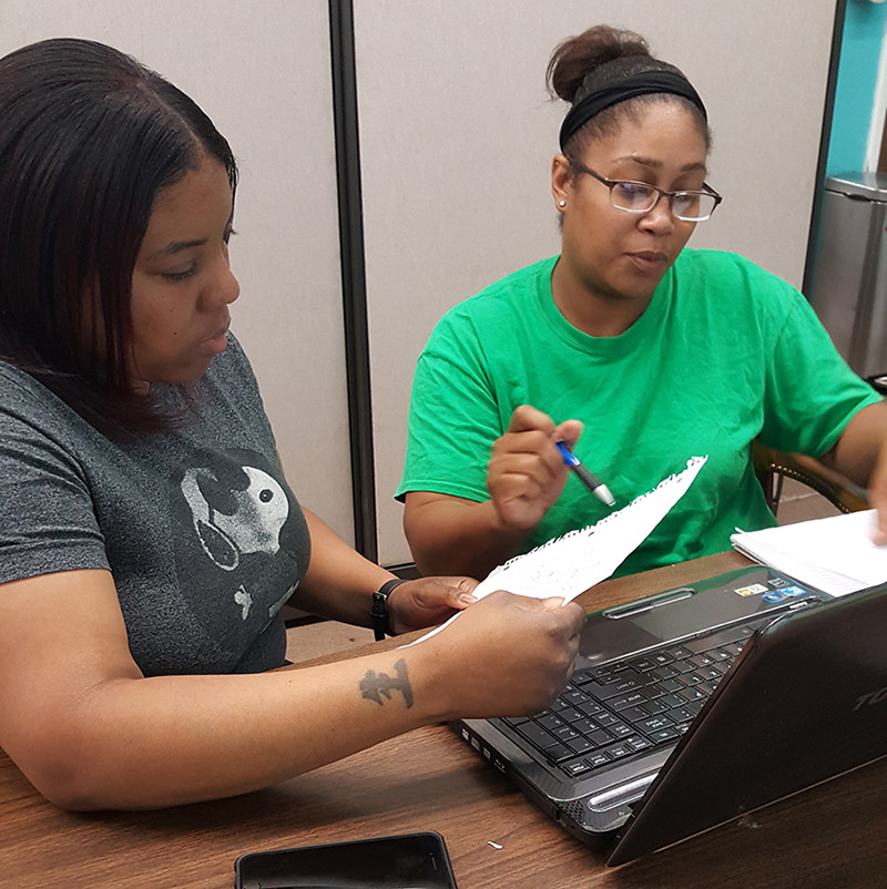 Akeera weathers, program coordinator, ASSISTING A pathways meMBER with her job search.