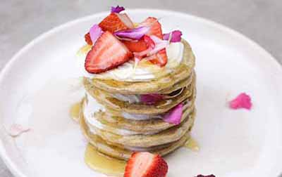GLUTEN FREE ALMOND MEAL PANCAKES WITH STRAWBERRIES & VEGAN WHIPPED COCONUT  Because. PANCAKES.